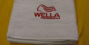 Вышивка на полотенце лого Wella